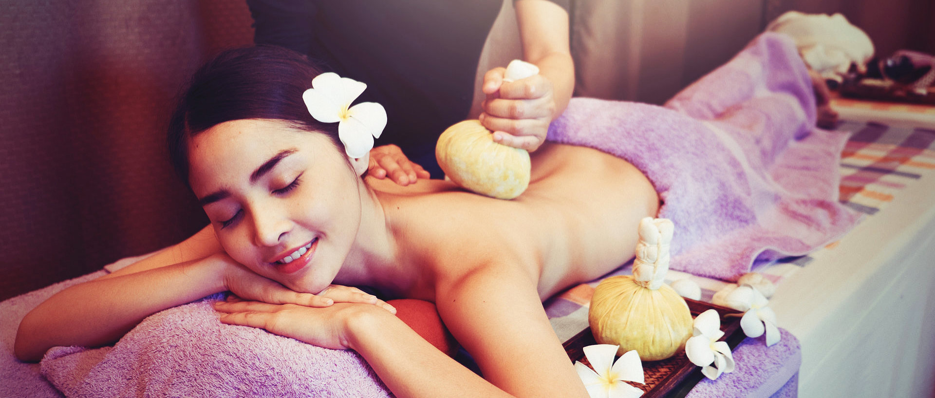 lady being massaged with crushed lemons in a very thin cloth